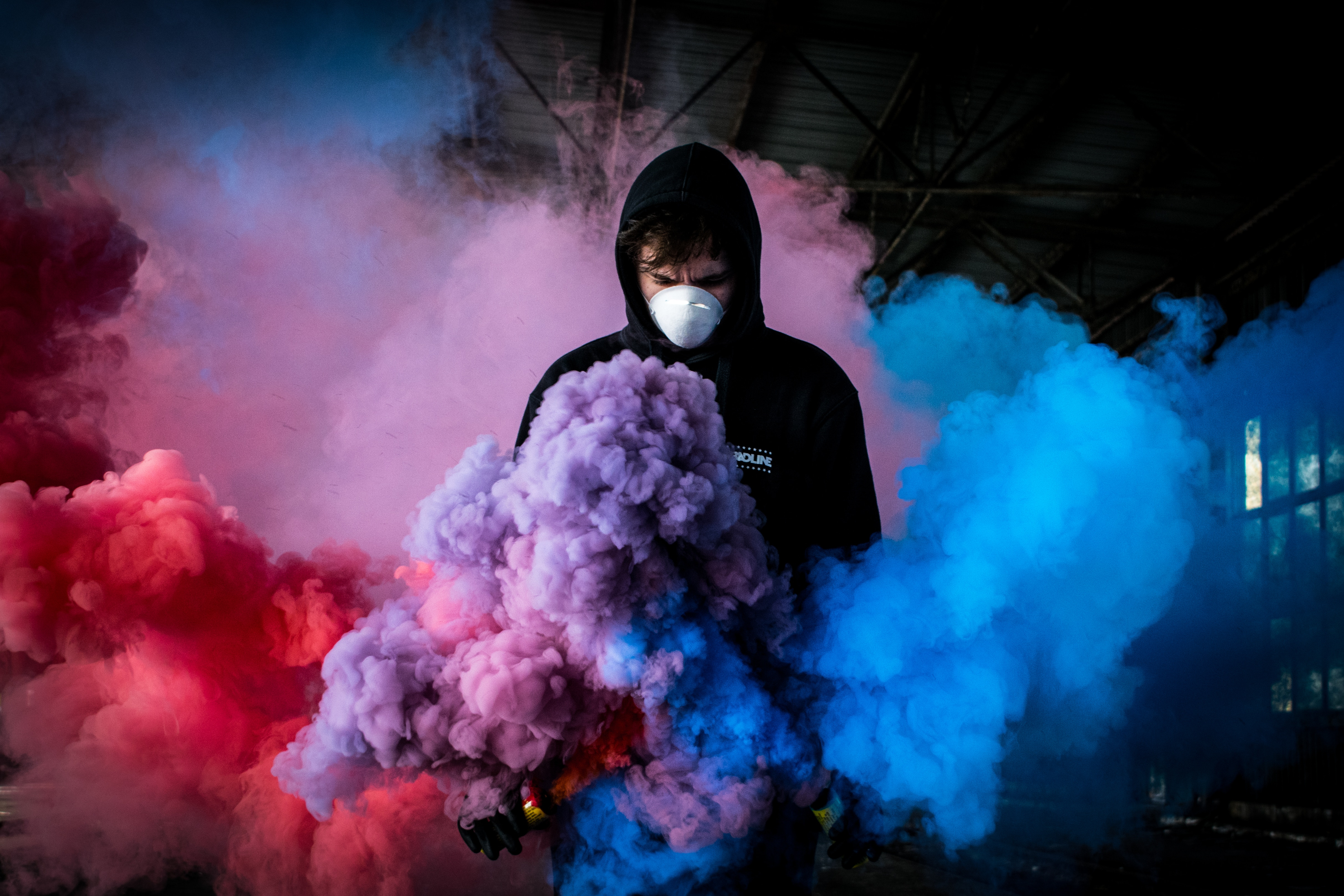 Boy with smoke bomb colorful 5k