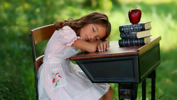 Child Sleeping On Table