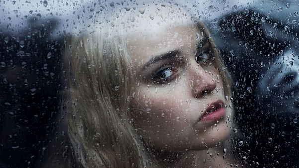 girl-behind-the-glass-with-water-drops-ad.jpg