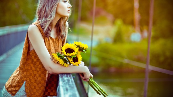 girl-standing-with-sun-flowers.jpg
