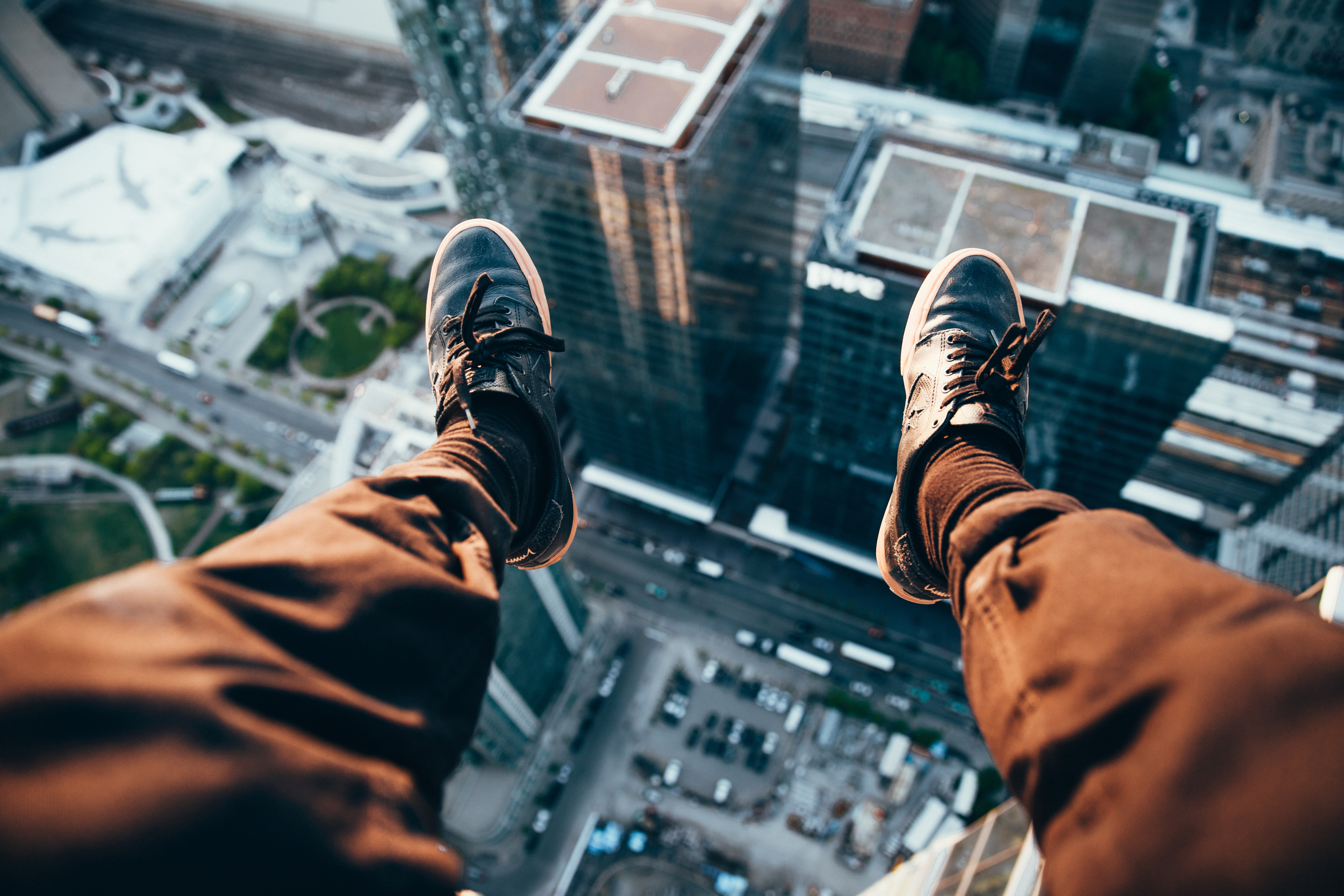 Man Sitting On Top Of A Rooftop Hd Photography 4k