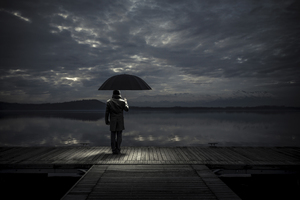 Alone man With Umbrella