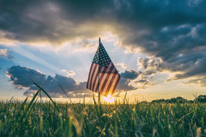 America Flag Inside Field Grass 4k