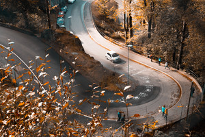 Autumn Road Orange Leaves Fallen Cars Peoples Walking 5k Wallpaper