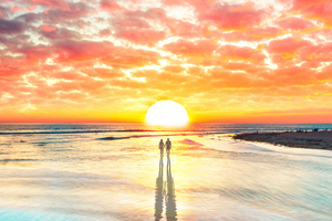 Beach Couple Watching Sunset 4k Wallpaper
