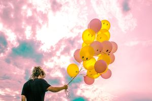 Boy With Happy And Sad Balloons Wallpaper
