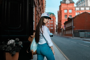 Brunette Wearing Baseball Cap Looking Back Wallpaper