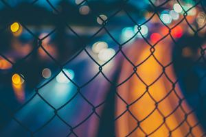 Chain Fence Long Exposure Orange Blue Blur 4k Wallpaper