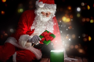 Christmas Santa Claus Opening Gifts Wallpaper