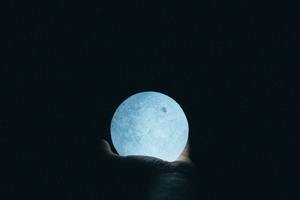 Close Up Photo Of Person Holding Moon Lamp Wallpaper