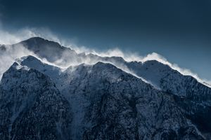 Clouds Over Snow Mountain Range Cliff Wallpaper
