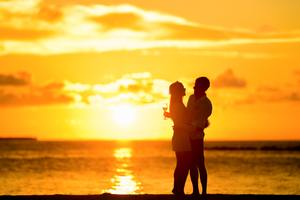 Couple At Beach During Sunset Wallpaper