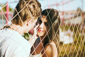 Couple Love At Fence Wallpaper