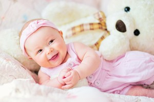 Cute Baby With Teddy Bear Wallpaper