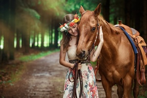 Cute Girl Smiling With Horse Outdoors