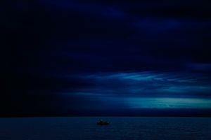 Dark Evening Blue Cloudy Alone Boat In Ocean 5k Wallpaper