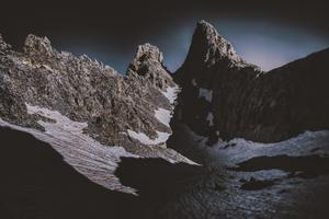 Dark Mountains Covered By Snow 5k Wallpaper