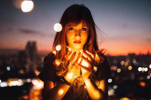 Girl Holding Fire Flies Wallpaper