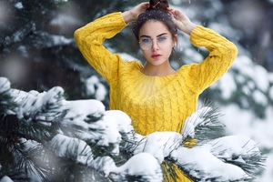 Girl In Snow Looking At Viewer Wallpaper