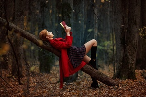 Girl Reading Book Lying On Back Outdoors Wallpaper