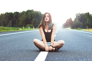 Girl Sitting On Road