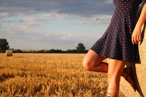 Girl Standing In A Field Wearing Polka Dot Dress Wallpaper