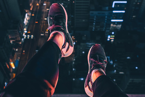 Hanging Shoes In Air City Night View 4k Wallpaper