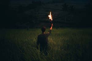 Man Through Dark With Wooden Torch Wallpaper