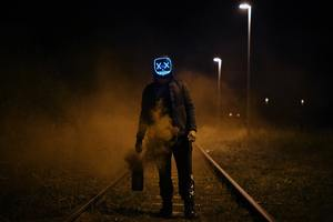 Mask Guy Walking On Railroad Wallpaper