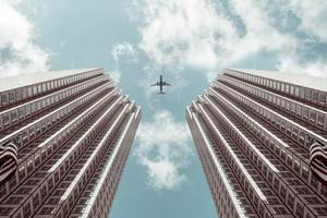 Plane Between Two Buildings 5k Wallpaper