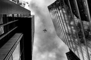 Plane Between Two Buildings Monochrome