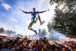 Player Jumping Out Of Burning Woods Wallpaper