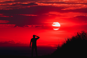 Silhouette Of Man During Red Sun