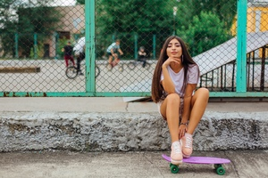 Skateboard Girl Sitting Smiling Portrait Wallpaper
