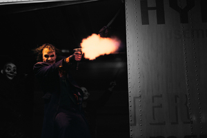 The Joker Firing A Glock In The Dark Knight Wallpaper