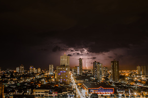 Thunderstorms Above City During Night Time Wallpaper