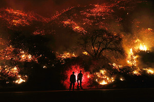 Two Man Standing In Front Of Forest Fire Wallpaper