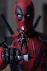 Ant Man Standing On Deadpool Gun