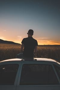 Boy Sitting On Top Of Car Watching Nature View 5k