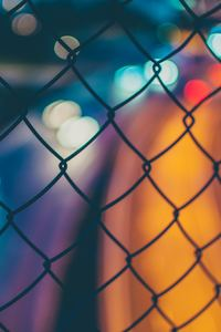 1125x2436 Chain Fence Long Exposure Orange Blue Blur 4k