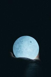 320x568 Close Up Photo Of Person Holding Moon Lamp