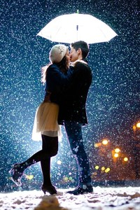 Couple Kiss In Snow