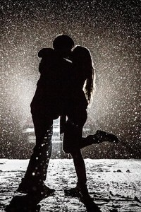Couple Kissing in Snow