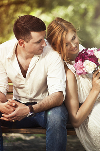 240x320 Couple Sitting On Bench With Flowers
