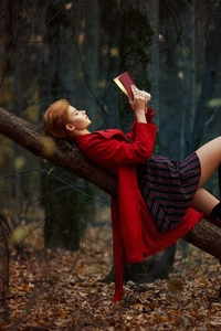 540x960 Girl Reading Book Lying On Back Outdoors