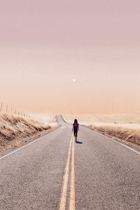 1080x1920 Girl Walking Alone On Desert Road