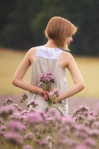 640x960 Girl With Flowers Standing In Field