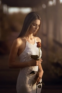 Girl With Rose In Hand