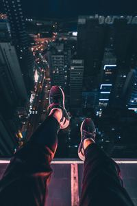 1080x2160 Hanging Shoes In Air City Night View 4k