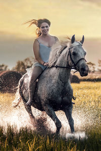 320x480 Happy Girl Riding Horse